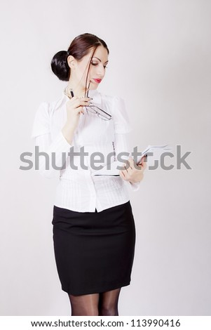 Attractive young businesswoman holding a contract paper - stock photo