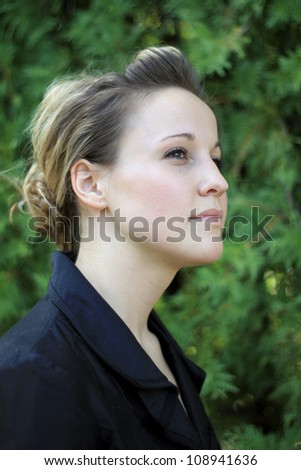 Attractive Young Businesswoman Looking to Side - stock photo