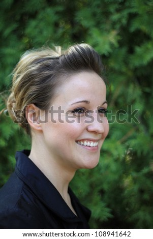 Attractive Young Businesswoman Looking to Side Smiling