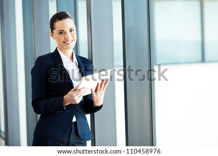 attractive young businesswoman using tablet computer - stock photo
