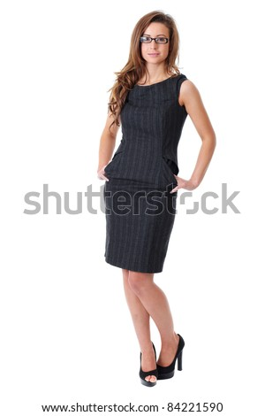 Attractive young businesswoman with specs wear grey elegant dress, isolated on white