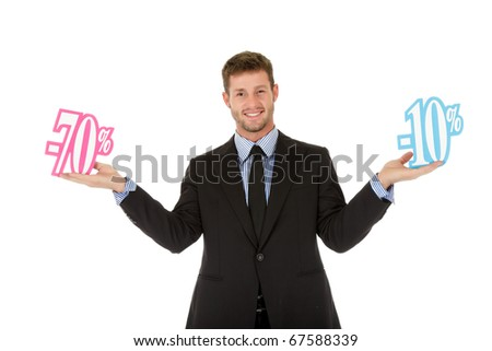 Attractive young caucasian businessman between seventy and twenty percent discount. Wondering what to choose. Studio shot. White background. - stock photo