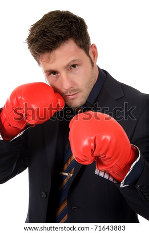 Attractive young caucasian businessman wearing boxing gloves. Studio shot. White background. - stock photo