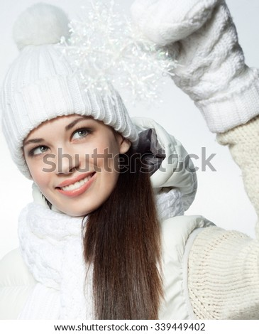 attractive young caucasian woman in warm clothing  in studio smiling