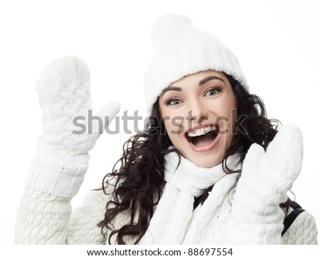 attractive young caucasian woman in warm  clothing  smiling - stock photo
