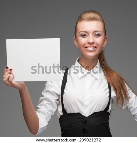 attractive young cheerful caucasian businesswoman holding sign isolated on white - stock photo
