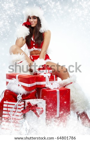 attractive young christmas women with the gift - stock photo