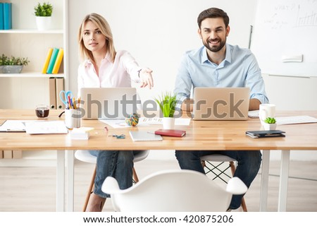 Attractive young colleagues have meeting with customer - stock photo