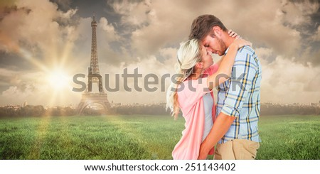 Attractive young couple about to kiss against paris under cloudy sky - stock photo
