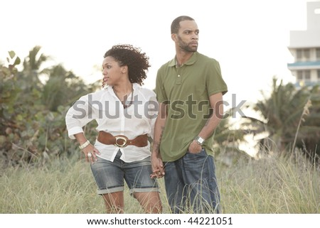 Attractive young couple at the beach - stock photo