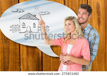 Attractive young couple embracing and looking against blue sky with clouds - stock photo