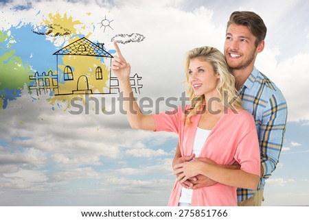 Attractive young couple embracing and looking against sky - stock photo