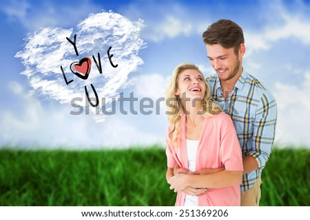 Attractive young couple embracing and smiling against cloud heart - stock photo