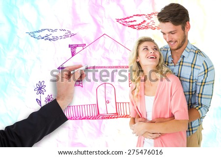 Attractive young couple embracing and smiling against crumpled white page - stock photo