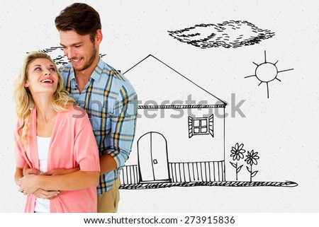 Attractive young couple embracing and smiling against grey - stock photo
