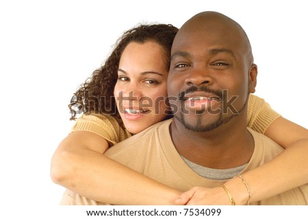 Attractive young couple hugging and smiling; portrait isolated on white - stock photo