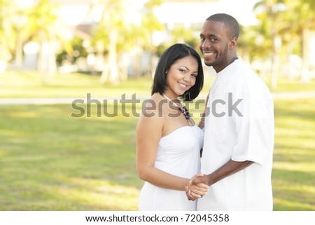 Attractive young couple in a nature setting - stock photo