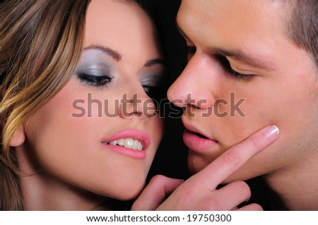 Attractive young couple in the moment just before they kiss - stock photo