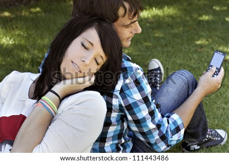 Attractive young couple listening to music