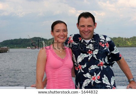 attractive young couple on boat - stock photo