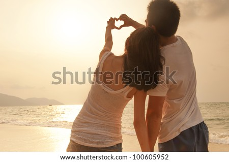 Attractive Young Couple on the Beach - stock photo