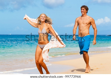 Attractive Young Couple on Tropical Beach - stock photo