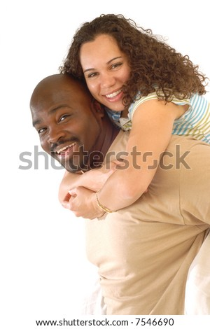 Attractive young couple playing around and laughing heartily