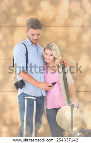 Attractive young couple ready to go on vacation against light glowing dots design pattern - stock photo