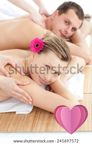 Attractive young couple receiving a back massage against heart