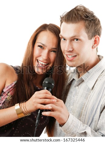 Attractive young couple singing, isolated on white background