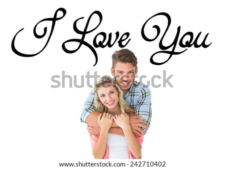 Attractive young couple smiling at camera against i love you - stock photo