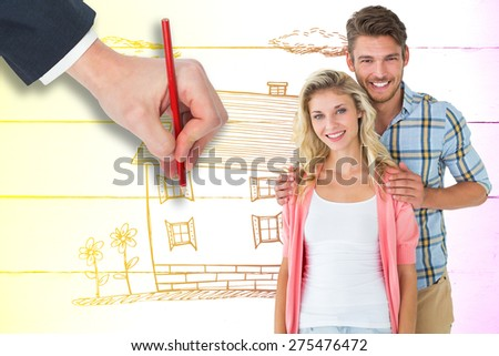 Attractive young couple smiling at camera against painted blue wooden planks - stock photo