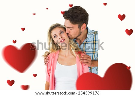 Attractive young couple smiling together against hearts - stock photo