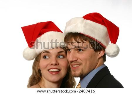 Attractive young couple with Santa Hats - stock photo