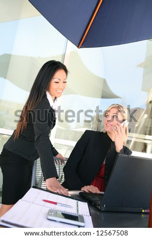 Attractive, young, diverse business woman team working on a project - stock photo
