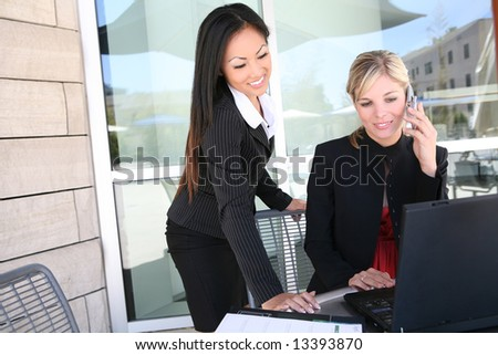 Attractive, young, diverse business woman team working on laptop computer