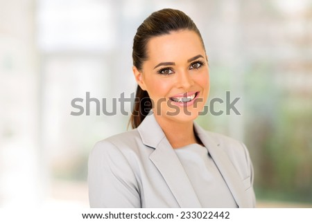 attractive young entrepreneur in modern office - stock photo