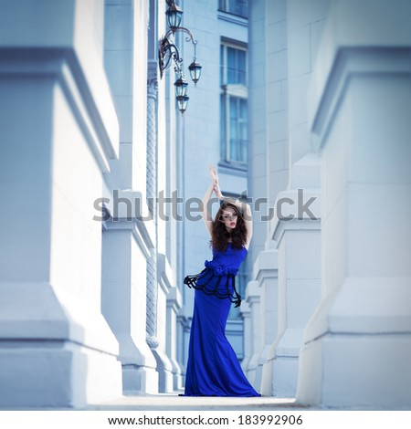 attractive young fashion woman in a city - stock photo