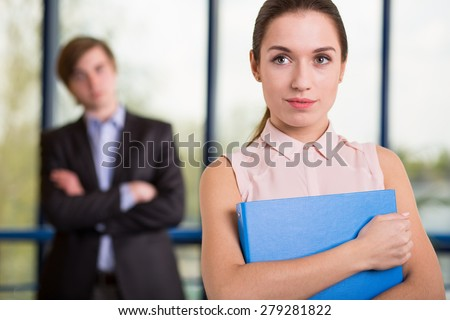 Attractive young female boss of big corporation - stock photo