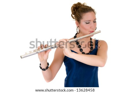 Attractive young female flautist, flutist holding flute. Evening dress.  Studio shot, white background.