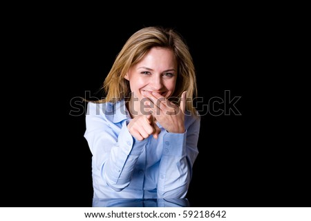 attractive young female laugh and point forward with her finger at the same time, studio shoot isolated on white background - stock photo