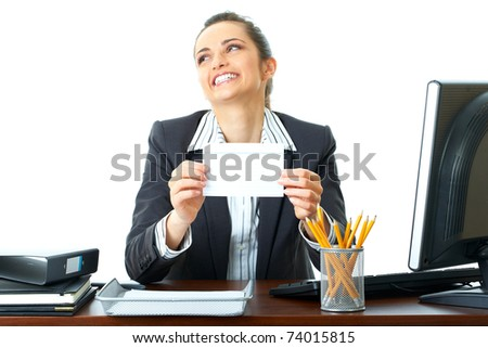 attractive young female office worker holds empty blank card in front of her, foreground focus, isolated on white background