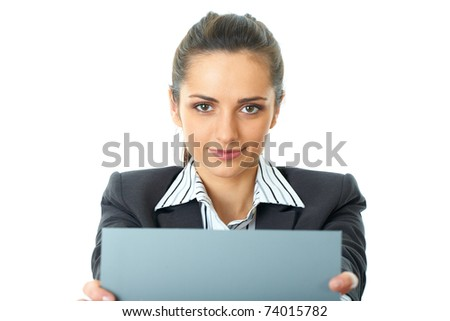 attractive young female office worker holds empty grey card in front of her, isolated on white