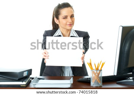 attractive young female office worker holds empty white card in front of her, isolated on white