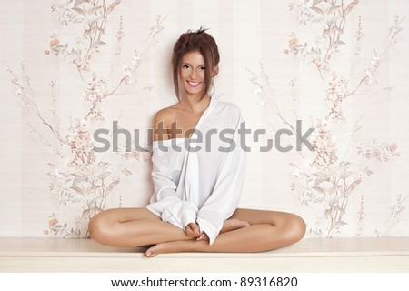 Attractive young female sitting in Lotus position. - stock photo