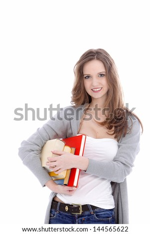 Attractive young female student in casual clothes smiling and carrying her books under her arm isolated on white