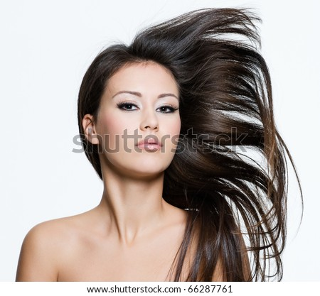Attractive young female with beautiful long brown hairs, posing isolated on white - stock photo