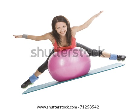 Attractive young female with fitness ball in stretching - stock photo