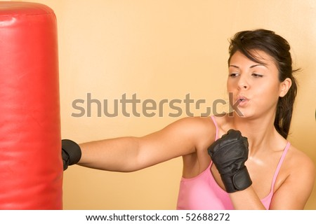Attractive young female working out on weight-lifting training machine - stock photo
