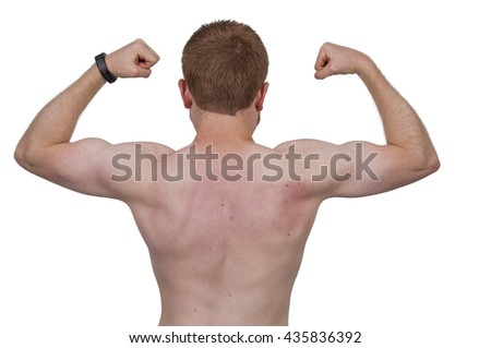 Attractive young fit muscular man standing with his back turned
